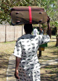 Woman carrying light luggage on her head